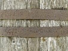 Detail of spotted hoops around vintage wooden barrel